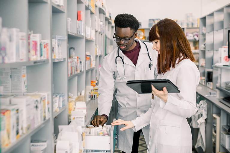 Pharmacists looking up a medicine for a patient